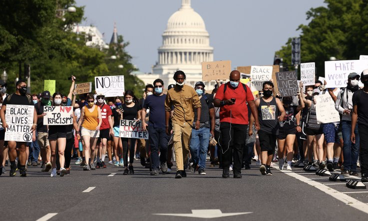 Demonstrators march down Pennsylvania Avenue to protest against police brutality and the death of George Floyd, on June 3, 2020 in Washington, DC.