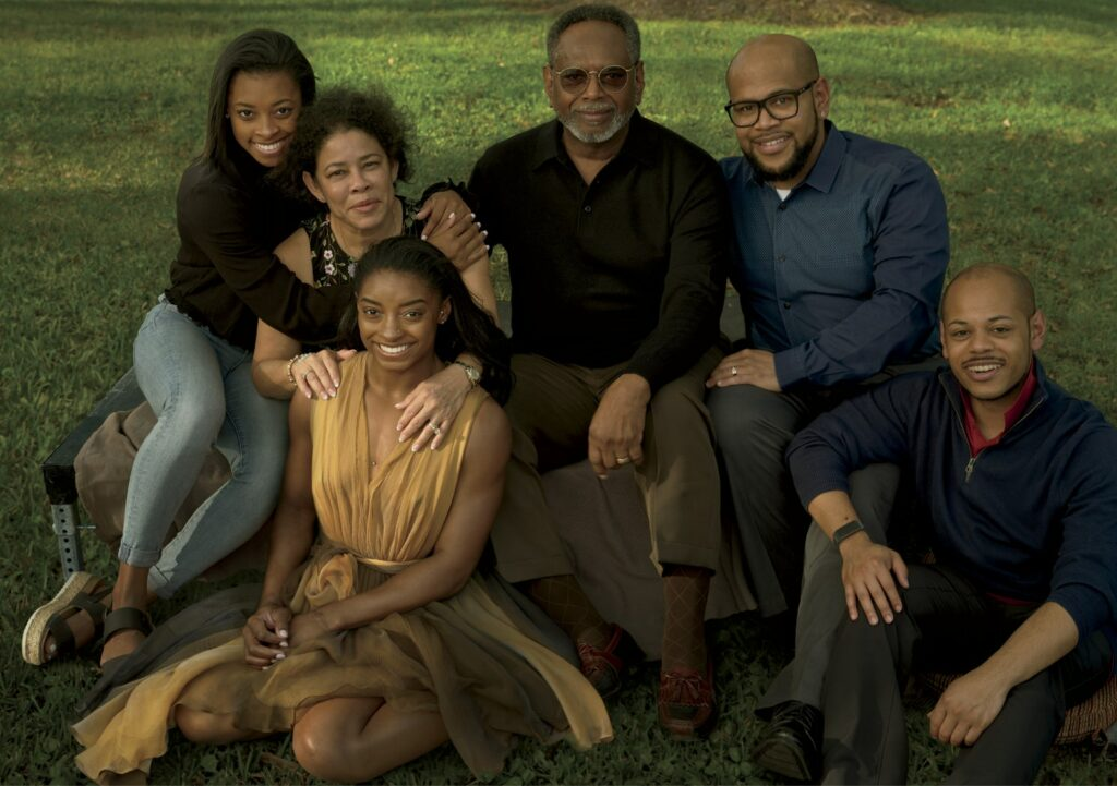 Biles (seated, wearing an Alaïa dress), photographed in February 2020 with her family in Spring, Texas. From left: Simone's younger sister, Adria, her parents, Nellie and Ron, and their sons, Ron II and Adam.